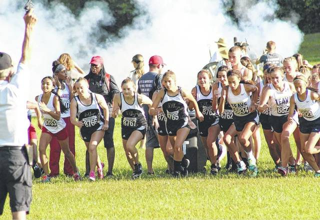 The Miami Trace girls are pictured at the beginning of the race Saturday, Sept. 23, 2017. (l-r); Saylor Preston (8766); Devan Thomas (8767); Abby Arledge (she is in behind Kylie Pettitt); Kylie Pettitt (8765); Lilly Litteral (8763) and Addie Barden (8762).
