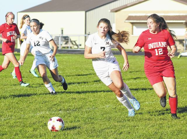 Miami Trace's Tori Morrison (7) races a Hillsboro player to the ball during a Frontier Athletic Conference match at Miami Trace High School Thursday, Sept. 28, 2017. Also pictured for Miami Trace are Krissy Ison (12) and Jillian Sollars.