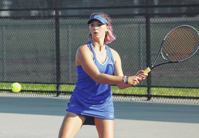 Washington's Megan Downing returns a shot during a first singles match at Miami Trace High School Tuesday, Sept. 26, 2017.