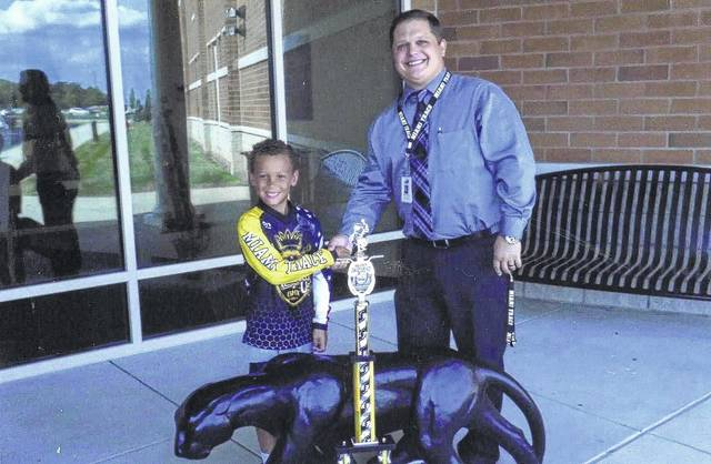 """On Sept. 24, Kevin (Hayden) Washington, a second grade student at Miami Trace, won the state championship for his age division in BMX Bicycle Riding. Washington rides for the """"Schooled U"""" BMX team. Washington is pictured with Miami Trace Elementary School Principal Ryan Davis."""