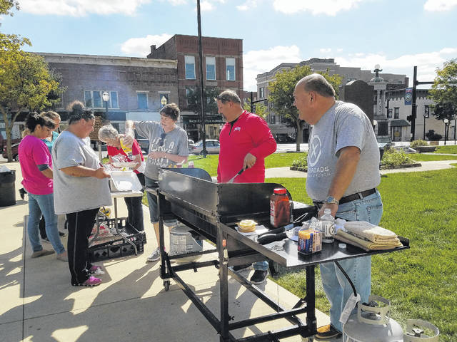"Crossroads Christian Church members and volunteers gathered Friday afternoon to give the community a ""shout out"" as a way to say thanks for the many services and goods offered by the businesses of Washington Court House. Crossroads took time to honor these businesses and employees by giving them a free meal on the Fayette County Courthouse lawn that they could eat there or take with them back to their work places."