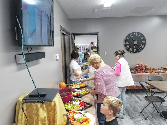 LIFE Pregnancy served refreshments during the event and showed a slideshow of photos from the process of creating the building.