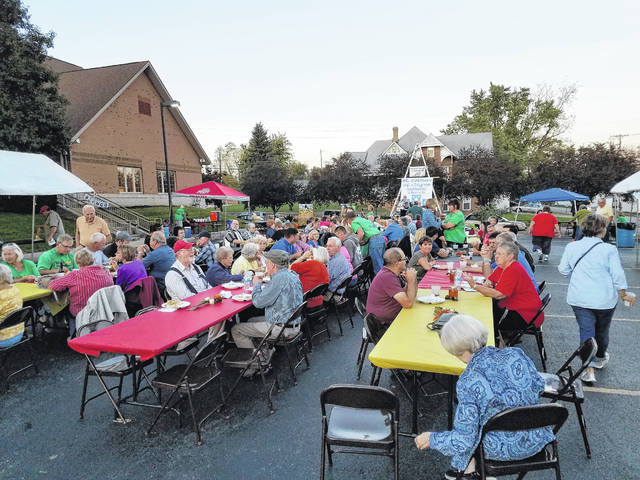 St. Colman Catholic Church held its annual Oktoberfest on Saturday. A large crowd gathered to feast, drink and be merry with traditional and modern German food and music.