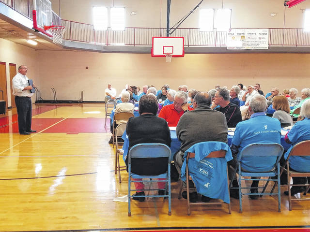 Buck Minyo, current Fayette County Family YMCA board chairman, addressed the guests and employees of the YMCA during the 10-year anniversary celebration on Friday afternoon. The celebration was held in the gym at the YMCA with various community leaders joining in the fun.