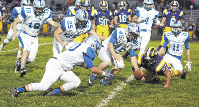 McClain suffered a fumble on a kickoff return during an Frontier Athletic Conference game against the Washington Blue Lions at McClain High School Friday, Oct. 13, 2017. The fumble was eventually recovered by No. 19, Alex Hamrick. For the Blue Lions (l-r); George Reno (1), Hamrick (19), Collier Brown (25), Trenton Henize (30), Jeremy Sluder (45), Caleb Rice (4) and Garitt Leisure (11).