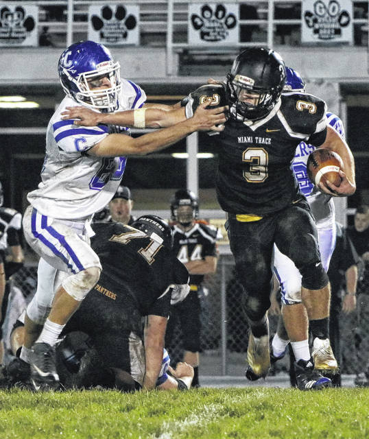 Miami Trace's Brady Wallace (3) tries to shed a Chillicothe defender during a Frontier Athletic Conference game at Miami Trace High School Friday, Oct. 13, 2017.