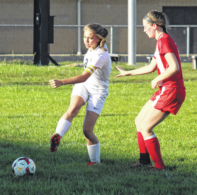Miami Trace's Cassidy Tolliver (left) moves the ball up the field during a Frontier Athletic Conference match against Jackson Tuesday, Oct. 3, 2017 at Miami Trace High School.