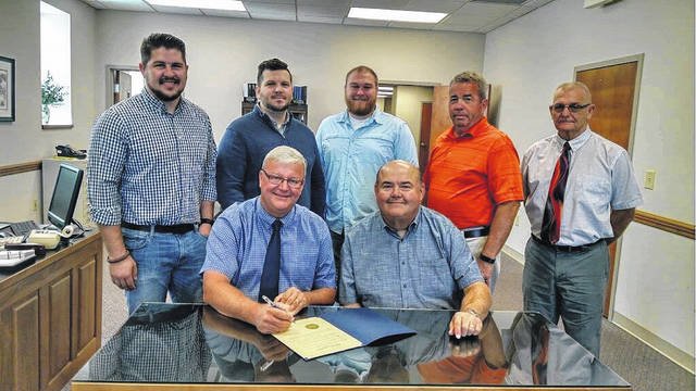 The Fayette County Commissioners signed a proclamation Monday acknowledging the efforts of Crossroads Christian Church to thank the area businesses for serving the community. The church will be serving meals on Oct. 13 from 11:30 a.m. to 1 p.m. on the Court House lawn as a way of showing their thanks. Pictured (L to R): seated: Commissioner Dan Dean and preaching minister for Crossroads Todd Maurer. Standing (L to R): youth minister Caleb Baumgardner, worship minister Nic Sims, children's minister Tanner Goss, and commissioners Tony Anderson and Jack DeWeese.