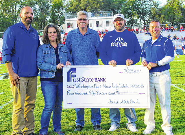 (From left to right): Mark Bihl, athletic director; Karen Cassidy, First State Bank office manager; Mark Richards, First State Bank manager; Tom Bailey, superintendent of Washington Court House City Schools; and Tracy Rose, high school principal.