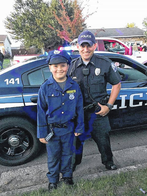 On Thursday, Officer Stapleton, the newest officer with the Washington Court House Police Department, passed out candy to children while patrolling. Pictured is Shane Skeeters and Officer Stapleton. Skeeters is the grandson of the retired former chief of police of Washington C.H., William E Robinson.