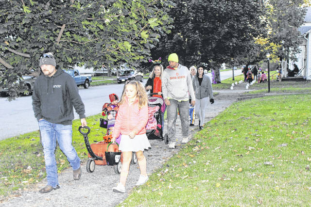 The City of Washington Court House held its annual Beggar's Night on Thursday evening. This group, walking down North North Street, enjoyed the mild weather and plenty of candy.