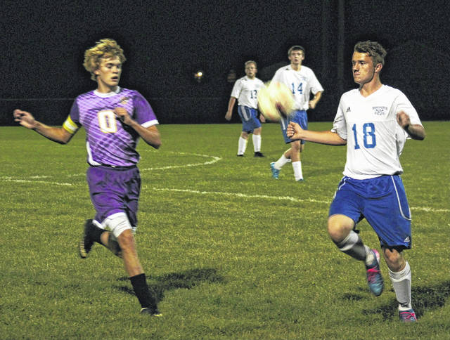 Washington's Isaiah Barden (18) looks to settle the ball against a McClain defender during a Frontier Athletic Conference match at Washington High School Tuesday, Oct. 3, 2017. Also pictured for Washington are Nick Bishop (14) and Alan Bailey (13).