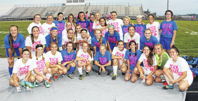 The Washington High School and Miami Trace High School soccer teams wore Kick Out Cancer t-shirts for their match Thursday, Oct. 5, 2017 at Miami Trace. Above, the players gathered and mingled together to show their solidarity for the cause.