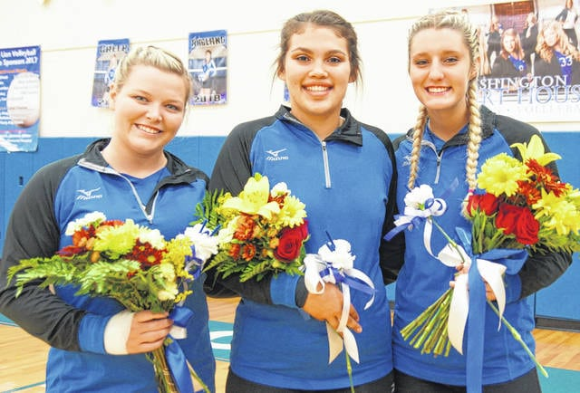 The Washington Lady Blue Lions honored their three seniors prior to the match against McClain (which Washington won), Tuesday, Oct. 3, 2017. (l-r); Delaney Greer, Trinity Ragland and Faith Kobel.