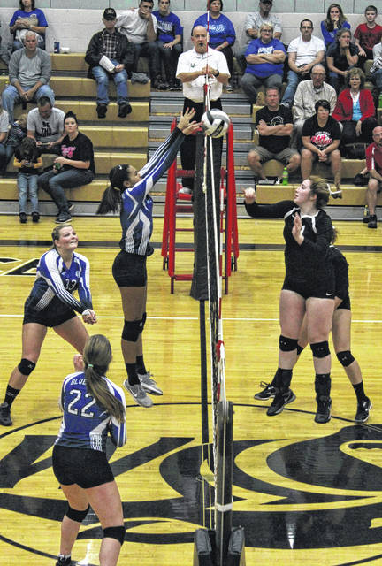Washington's Rayana Burns, left, blocks at the net during a Frontier Athletic Conference match at Miami Trace High School Thursday, Oct. 5, 2017. Pictured at right for Miami Trace is Erica Marshall. Also pictured for Washington are Delaney Greer and Halli Wall (22).