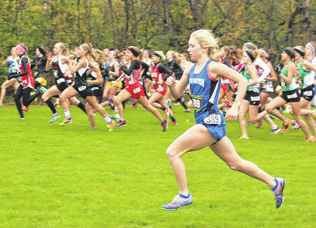 Washington High School senior Maddy Garrison (389) at the start of the Division II Regional cross country race Saturday, Oct. 28, 2017 at Pickerington North High School. Garrison placed 17th out of a field of 153 to advance to Saturday's State cross country championship at Buckeye Trail Raceway near Hebron.