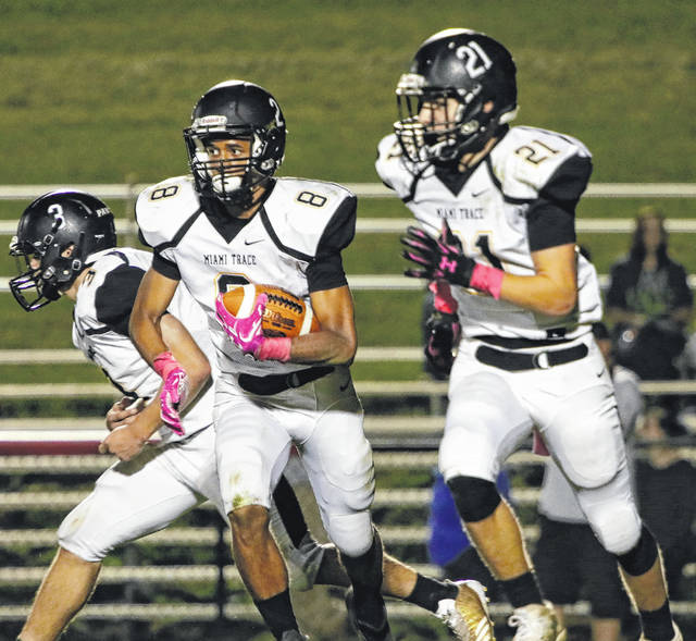 Malik Jackson (8) carries for Miami Trace during a Frontier Athletic Conference game at Hillsboro Friday, Oct. 20, 2017. Also pictured for the Panthers are Brady Wallace (3) and Caden Sweitzer (21).