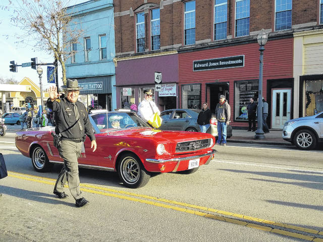 Fayette County's first responders and emergency personnel were honored at the 2017 Christmas Parade on Sunday in downtown Washington C.H. Pictured is Sheriff Vernon Stanforth (at left) and Washington Court House Police Chief Brian Hottinger leading the parade through the city.