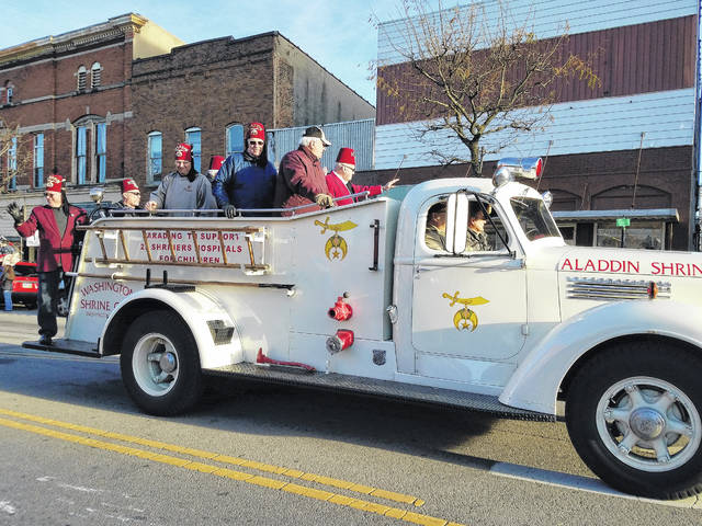 The Washington Shrine Club took time to break out the old fire engine and ride through town Sunday during the 2017 Christmas Parade.