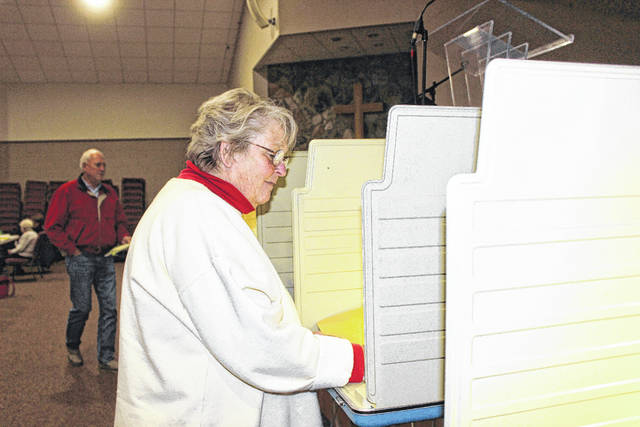 Bev Mullen reviews her ballot Tuesday afternoon.