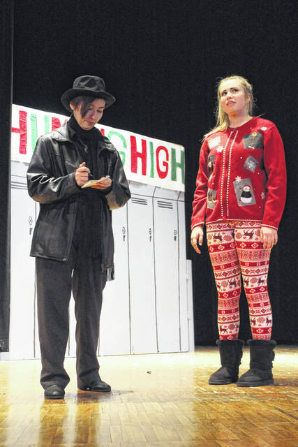 """The Miami Trace High School cast and crew of the upcoming production of """"Humbug High"""" invite the community to join them as they re-imagine a classic holiday story. Pictured (L to R) is Sydni Ward and Khenadi Grubb at practice Wednesday afternoon."""