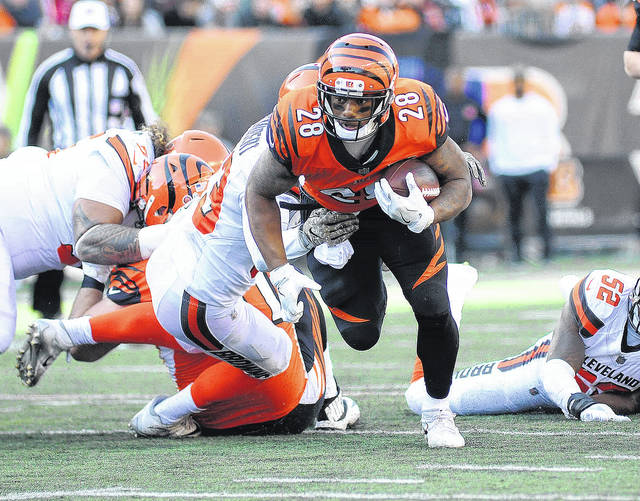 Cincinnati's Joe Mixon (28) rushes for a few of his 114 yards in a 30-16 win over Cleveland, Sunday, Nov. 26, 2017 in Paul Brown Stadium.