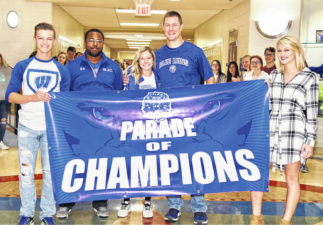Washington High School senior Maddy Garrison got a big surprise Friday when the band and students turned out to wish her the best of luck at the State cross country meet Saturday. (l-r); Grant Patterson, coach Louis Reid, Garrison, coach Ryan Day and Megan Rohrer.