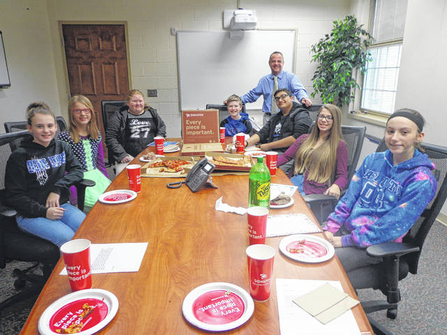 "Donatos recently provided pizza to these students at Washington Middle School as they celebrated ""Pizza with the Principals."" This is in appreciation for their selection as Students of the Month for November. They are chosen by their teachers because of the outstanding example they set for their peers in such areas as academic effort, good work ethic, kindness to others, and service to their school. Pictured from left: Addison Shiltz, Arian Taylor, Casie Williams, John Wall, WMS assistant principal Mr. Montgomery, OM Patel, Nevaeh McNichols, Kaitlyn Coder, absent from picture- Tiara Erskine."