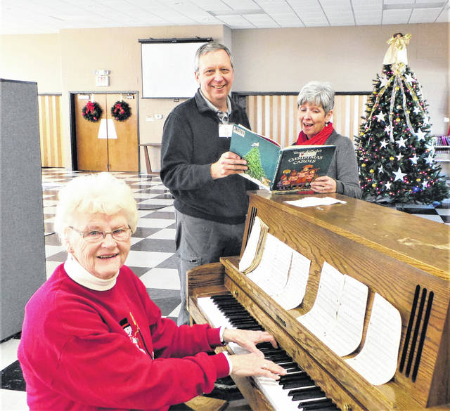 The Fayette County Retired Teachers Association's early-December luncheon meeting at Grace United Methodist Church concluded on a joyous note: singing Christmas carols to music played by Mary Sue Spengler, retired principal from a Miami Trace former elementary school. Shown at the piano with Spengler are Dick and Maggie Glass, director and member respectively of the First Presbyterian Church choir.