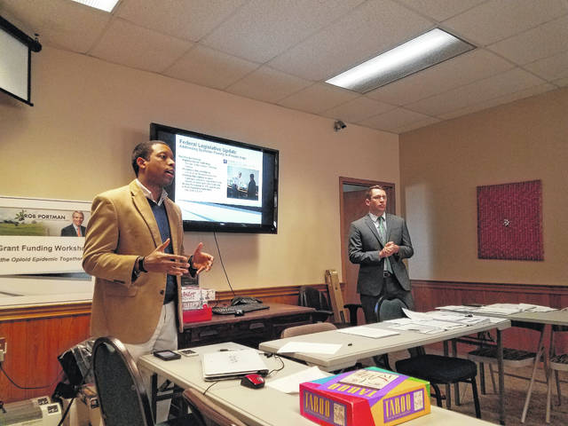 Stephen White (left), Sen. Rob Portman's central Ohio director, led a grant funding workshop with Jason Knox, grant coordinator for Portman, Monday afternoon at the Community Action Commission of Fayette County. The two explained the efforts of Portman at all levels to help combat the opioid epidemic, as well as took time to listen to the concerns of community leaders.