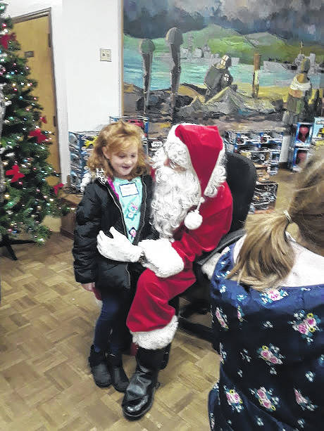 The kids watched a magic show, met Santa Claus and were gifted toys and clothes after lunch.