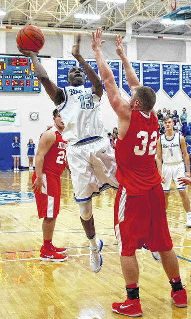 Washington Blue Lion junior Blaise Tayese shoots around Hillsboro senior Phil Mycroft (32) during a Frontier Athletic Conference game Friday, Dec. 8, 2017. At right is Washington sophomore Eli Lynch (1). Also pictured for Hillsboro is junior Josh Keets.