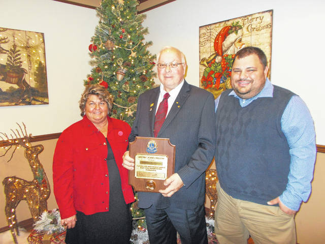 """David Ross of Greenfield has been a Good Hope Lions Club member for over 20 years and he recently received the """"The Melvin Jones Award."""" Ross is shown with the award with his wife, and Lion President Branen Weade at the Ladies night dinner."""