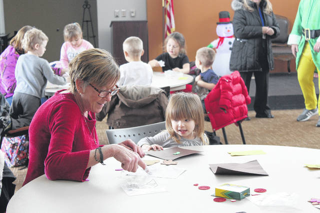 """Fayette Progressive Schools, on Leesburg Avenue, gave students a ride on the """"Polar Express"""" and a unique Christmas experience for both the morning and afternoon classes Tuesday. Pictured is Melissa and Carly enjoying the crafts during the event at Southern State Community College"""