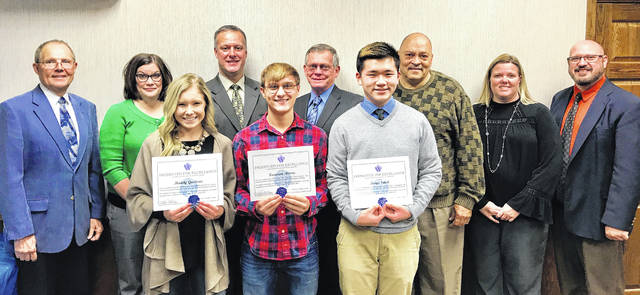 Washington Court House City Schools senior Maddy Garrison, junior Kameron Morris and senior Keiya Satoh were honored at the board of education November meeting for excellence. The students are pictured with (back row left to right) board of education members Jon Creamer, Jennifer Lynch, Craig Copas, Jim Teeters and Ken Upthegrove, as well as CFO/treasurer Becky Mullins and superintendent Tom Bailey.