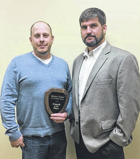 Justin Johnson, left, recently received the Coach of the Year award for the Miami Trace Youth Football Program for 2017. Presenting the award is Rob Guthrie, chairman of the MTYFP. Johnson is the head coach of the Sixth Grade White Team.