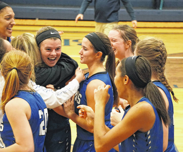 CELEBRATING GOOD TIMES — The Lady Lions celebrate after defeating Bishop Hartley Saturday, Dec. 9, 2017, 63-61. (l-r); Hannah Haithcock, Emily Semler (white long sleeved shirt), Maddy Garrison is hugging Shawna Conger (who shot the winning basket), Tabby Woods (front left), Kassidy Hines (to the right of Shawna and Maddy), Halli Wall (back right), Maddy Jenkins (braided hair) and Rayana Burns.