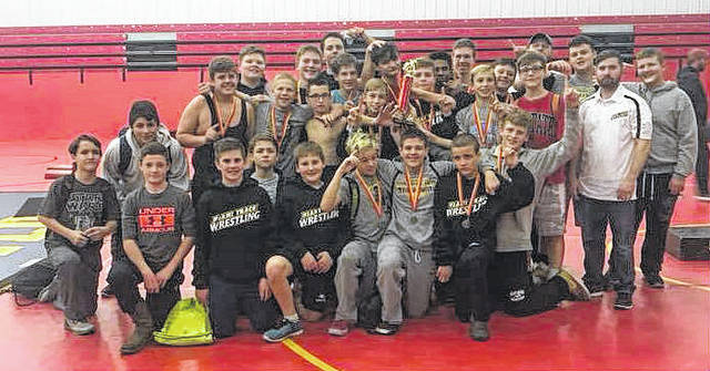 The Miami Trace Middle School wrestling team enjoys the moment after winning the Bishop Fenwick Invitational.