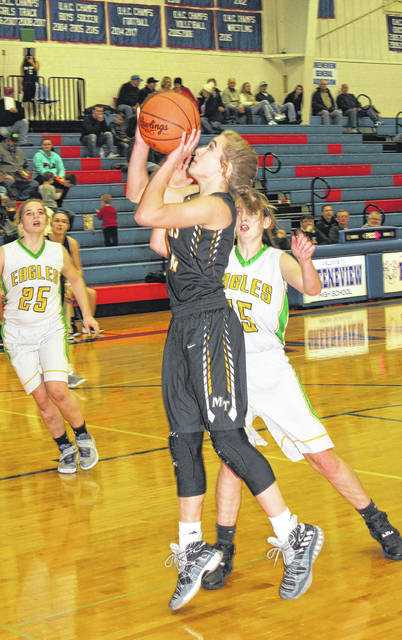 Miami Trace freshman Olivia Fliehman takes the ball to the basket against Madison Plains in the opening round of the 2017 McDonald's Holiday Tournament Wednesday, Dec. 27 at Greeneview High School.