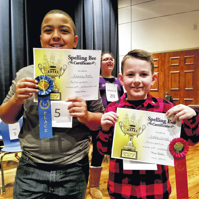 Fifth-grader Issac Hood (left) was named the 2017 Spelling Bee Champion and fourth grader Cooper Collins was the runner-up.