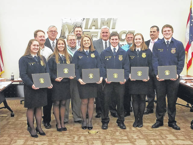 The Miami Trace FFA Parliamentary Procedure state champions were honored Monday evening at the first school board meeting of 2018. Several students and the advisors for the chapter were all presented with a certificate by David Lewis, Miami Trace Superintendent. Members honored (L to R) were: front row: Aubrey Schwartz, Kylie Pettit, Abbi Pettit, Garrett Hagler, Meri Grace Carson, and Adam Ginn. Back row (L to R): Bruce Bennett, Charlie Andrews, Bruce Kirkpatrick, David Lewis, Mike Henry, David Miller and Rob Dawson. Additionally, the team had two alternates who were not pictured: J.M. Perrill and Khenadi Grubb.