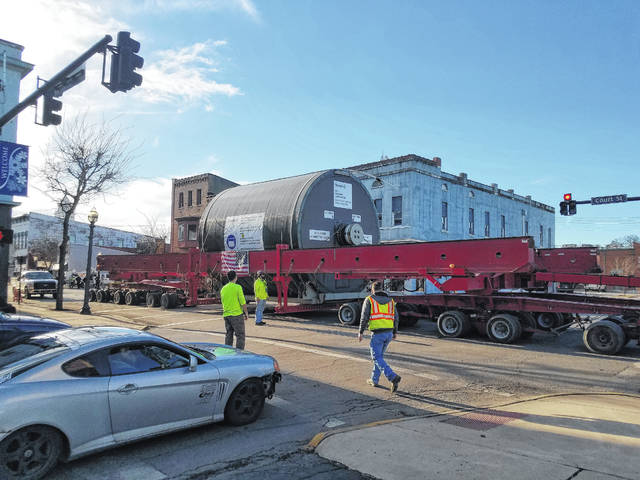 A giant trailer carrying two large dryers from Tennessee that will be utilized at a new 1.4 million-square-foot tissue plant in Pickaway County traveled through downtown Washington Court House Friday. Traffic was stopped in all directions as crews needed to carefully maneuver the behemoth of a load under traffic lights and through the downtown area.