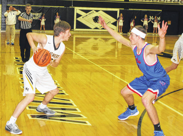 Miami Trace senior Dakota Bolton (left) is guarded by Clinton-Massie junior Matt Phillips during a non-league game at the Panther Pit Wednesday, Jan. 3, 2018.