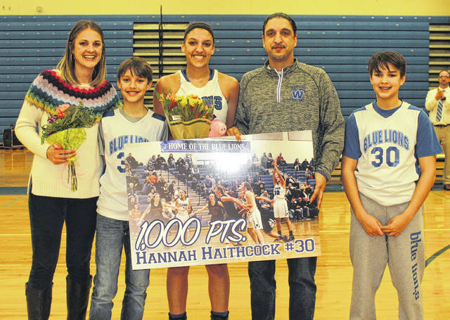 Washington High School junior Hannah Haithcock, above, middle, reached the 1,000-point scoring mark for her career with 3:26 to play in the third quarter of a non-conference game against Huntington Wednesday, Jan. 24, 2018 at Washington High School. The game was stopped for a few moments to recognize her achievement. She is joined by her family, above (l-r); mom Angie, brother Noah, Hannah, dad Steve and brother Isaiah. For more on the game, please see today's sports.
