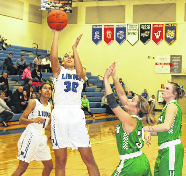 Washington junior Hannah Haithcock puts up a shot for two of her team-high 27 points against Huntington Wednesday, Jan. 24, 2018 at Washington High School. Also pictured for Washington is Rayana Burns. Haithcock reached the 1,000-point mark with a basket with 3:26 to play in the third quarter. She now currently has 1,007 career points.