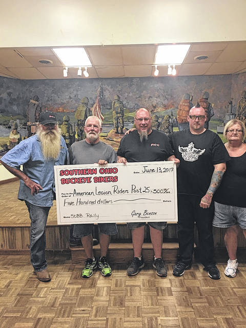 """The Southern Ohio Buckeye Bikers donated a check for $500 to the American Legion Riders Post 25 last year to be used to assist local veterans. The riders decided to use the money to refurbish a wheelchair that had been donated. Pictured (L to R): Jimmy """"Chicken Man"""" Morrison, Brian Finney, Gary Benson, DJ Jenkins and Sandy Rodgers."""