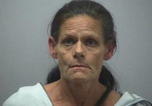 Woman admits to being outside jail with narcotics as inmates lowered rope from window