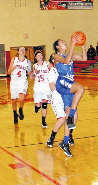 Washington sophomore Rayana Burns takes the ball to the basket for two of her game-high 13 points during a Frontier Athletic Conference game at Hillsboro High School Wednesday, Jan. 3, 2018.