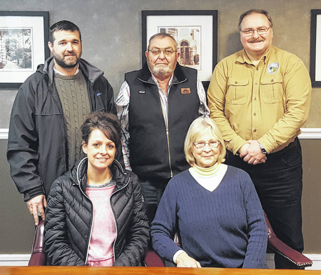 The closing on the agricultural easement was recently held. Front, Jami Sears and Deborah Sears; back, Jess Sears, Douglas Sears, and FSWCD Director Chet Murphy.