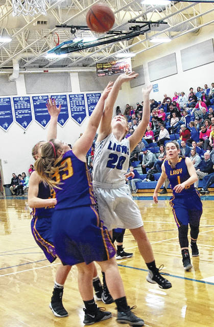 Washington junior Tabby Woods (20) puts up a shot during a Frontier Athletic Conference game against the McClain Lady Tigers Wednesday, Jan. 31, 2018 at Washington High School.
